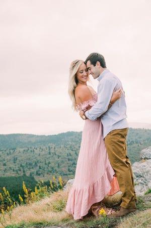 Hayley Watts and Sam Hajjar embrace in an engagement photo in Asheville, North Carolina.