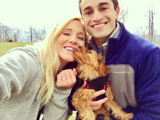Hayley Watts and Sam Hajjar snap a selfie  Dec. 3, 2016 with their dog Benji in Banner Elk, North Carolina's Eagle's Nest neighborhood, where they planned to get married Saturday.