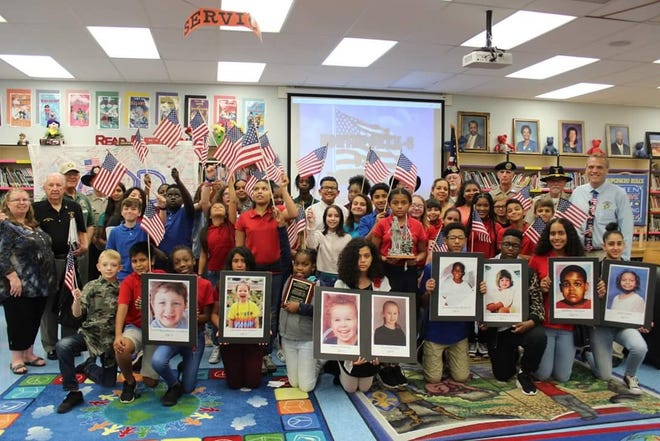 Northport student teachers along with Vietnam Veterans, Chapter 566 and Principal, Glenn Rustay participate in 9/11 Remembrance.