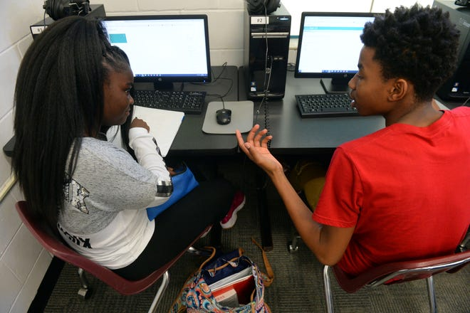 "Vero Beach High School 10th-grader Kytiana Williams (left) and Sebastian River High School 11th-grader Jamyle Newman discuss their respective homework Wednesday, Sept. 12, 2018, while working in the computer lab at the Gifford Youth Achievement Center in Indian River County. Gifford is currently adding 14,000-square-feet of space which will add eight new classrooms for middle and high school students who use the center's after-school program and summer camp. ""The expansion is taking place because we run a waiting list between 40 and 60 students,"" said Angelia Perry, executive director for the center. ""We just don't have enough space despite adding modular units over the years. With the expansion, we anticipate serving 125 additional students and bring our total of students served close to 300."" Construction for the expansion is expected to be completed in the spring of 2019."