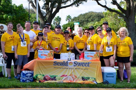 The Walk To Remember Team from Seald Sweet gets ready for the 2017 event at Riverside Park in Vero Beach.