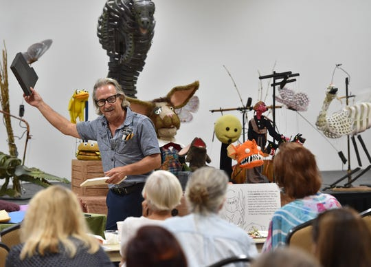 "David Jordan, from Ibex Puppetry of Orlando, holds up a block of microcell foam while describing materials he uses to manufacture puppets during a puppetry class held for educators and artists on the history of puppetry and how it can be used in education on Thursday, Sept. 13, 2018, at the Havert L. Fenn Center in Fort Pierce. ""It's a blessing to be able to do puppetry, it's a great art form,"" Jordan said. ""It's such a broad deep well of exploration, materials, subjects, all of them."""
