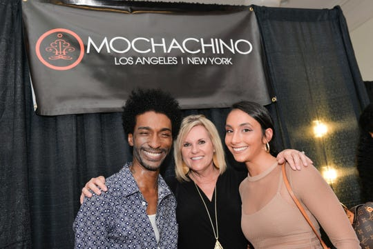 "Fashion designer Sabre Mochachino, left, with Dana Trabulsy and Joanna Gambina at the 2018 ""Undeniable"" fashion show in Fort Pierce benefiting GraceWay Village."