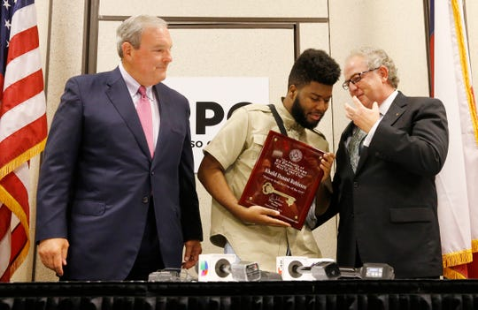 El Paso Mayor Dee Margo, recording artist and El Pasoan Khalid along with President and CEO of the El Paso Chamber David M. Jerome share a moment before the start of a short press conference. Margo presented the Key to the City during  the State of the City address at the El Paso Convention Center Thursday afternoon to Khalid.