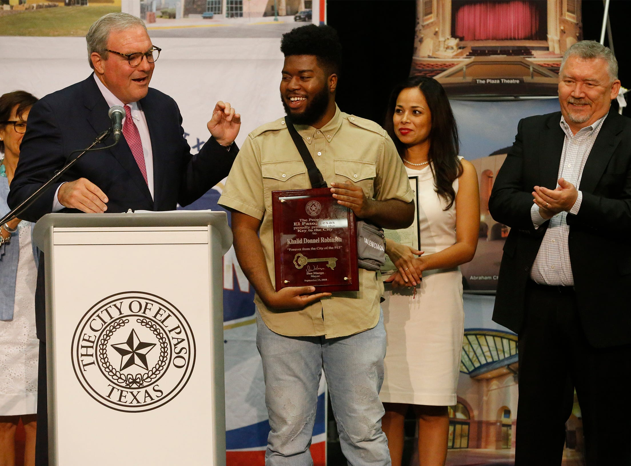 El Paso Mayor Dee Margo presents the Key to the City to El Pasoan Khalid shortly after delivering his State of the City address, which was held Thursday afternoon in the El Paso convention center. The mayor was joined by members of the City Council as he presented the award-winning music star with the honor.