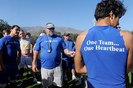 Nordhoff head coach Lance Wiggins gathers his team during Wednesday's practice. The Rangers are off to a 3-1 start and will face unbeaten Santa Paula in a Citrus Coast League opener Friday night.