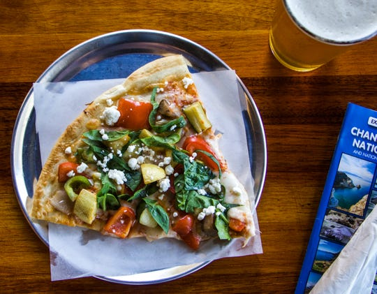 A pizza is served up at Fratelli's Pizza & Brew in the Ventura Harbor Village.