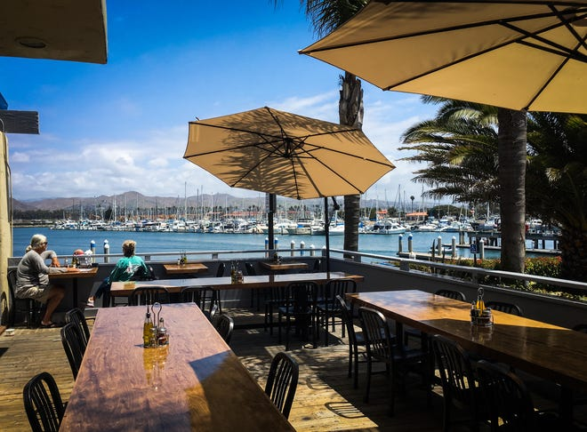 Diners at Fratelli's Pizza & Brew in Ventura Harbor Village can enjoy the harbor while dining outdoors.