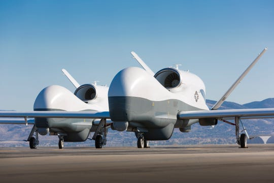 Two Northrop Grumman MQ-4C Triton unmanned aerial vehicles are seen on the tarmac at a Northrop Grumman test facility in Palmdale.