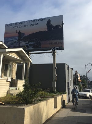 Critics say this billboard along Ventura Avenue, put up by the city of Ventura, sends the message that the beach is for white people only.