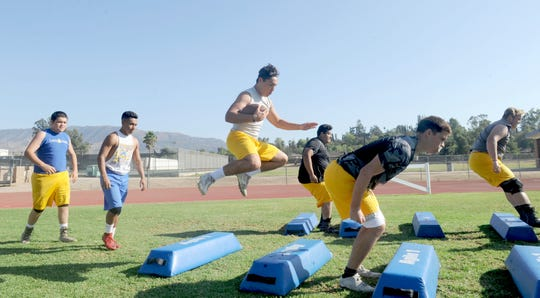 Nordhoff High football players practice jumping over some bags during Wednesday's practice. The Rangers were preparing for Friday night's showdown with Santa Paula.