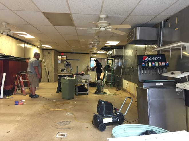 Jim's Lunch was open on Thursday, but it was only to allow renovation work inside. The city on Thursday received a bid of $210,000 to repair one wall damaged in the demolition of an adjacent building this year.