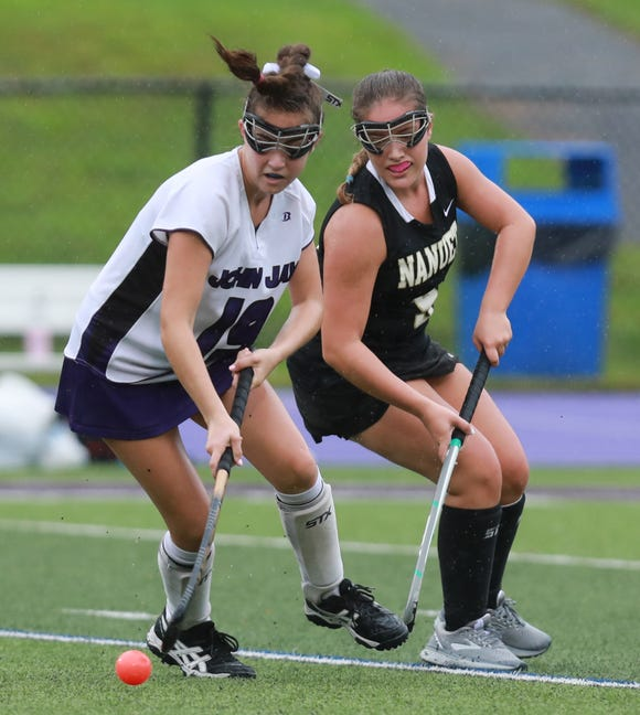 John Jay's Melina O' Connor (19) and Nanuet's Lily Kroenung (9) battle for control of the ball during girls field hockey game at John Jay High School in Cross River on Sept. 13, 2018. John Jay defeats Nanuet 3-1.
