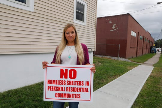 Lyndsay Fitzgerald is concerned about the new location of the Jan Peek House homeless shelter to Washington Street in Peekskill on Sept. 13, 2018. The new shelter has local residents concerned because of the close proximity to their homes.