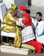 Pope John Paul II embraces newly created Cardinal, Theodore McCarrick, at the Vatican in 2001.