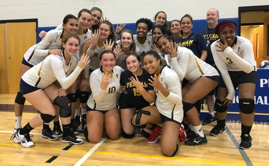 Pelham volleyball head coach Mark Finegan poses with the team after collecting his 400th career win in a sweep over Yorktown at Pelham Middle School. Sept. 12, 2018.