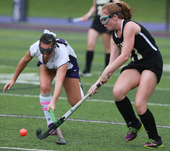 Nanuet's Molly Darcy (11) tries to steal the ball from John Jay's Rosie Ceisler during girls field hockey game at John Jay High School in Cross River on Sept. 13, 2018. John Jay defeats Nanuet 3-1.
