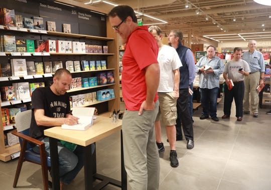 New York Times best-selling author and Mahopac alumnus Jeff Pearlman signs his latest book on the USFL at Barnes & Noble in Scarsdale Sept.12, 2018.