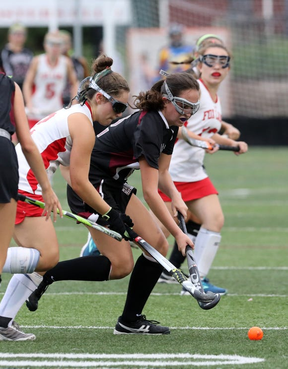 Elizabeth Scarsella of Scarsdale blocks Claudia Hirsch of Fox Lane in the second-half of their field hockey game at Fox Lane High School Sept. 13, 2018 in Bedford. Scarsdale won, 6-1.