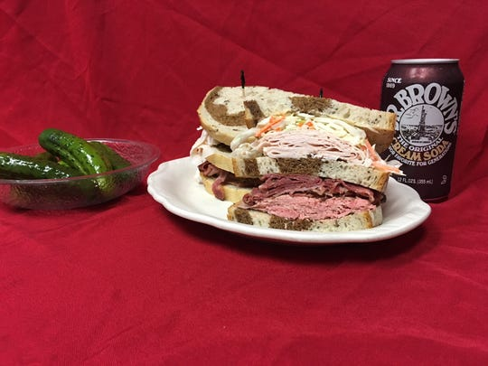 In Vernon, Connecticut, at Rein's New York Style Deli, the Tappan Zee is a popular triple sandwich featuring roast beef, turkey and pastrami on three slices of rye bread.