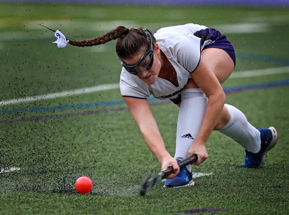 John Jay's Cara O'Reilly (6) keeps the ball away from Nanuet during girls field hockey game at John Jay High School in Cross River on Sept. 13, 2018. John Jay  defeats Nanuet 3-1.