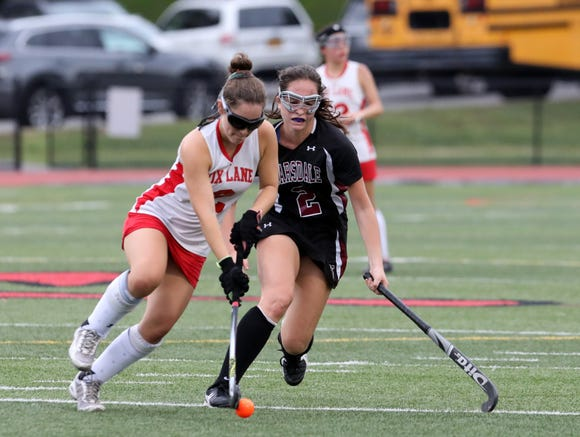 Claudia Hirsch of Fox Lane plays the ball against Elizabeth Scarsella of Scarsdale in the second-half of their field hockey game at Fox Lane High School Sept. 13, 2018 in Bedford. Scarsdale won, 6-1.