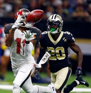 Tampa Bay Buccaneers wide receiver DeSean Jackson (11) pulls in a touchdown reception in front of New Orleans Saints cornerback Ken Crawley (20) in the second half of an NFL football game in New Orleans, Sunday, Sept. 9, 2018. (AP Photo/Butch Dill)
