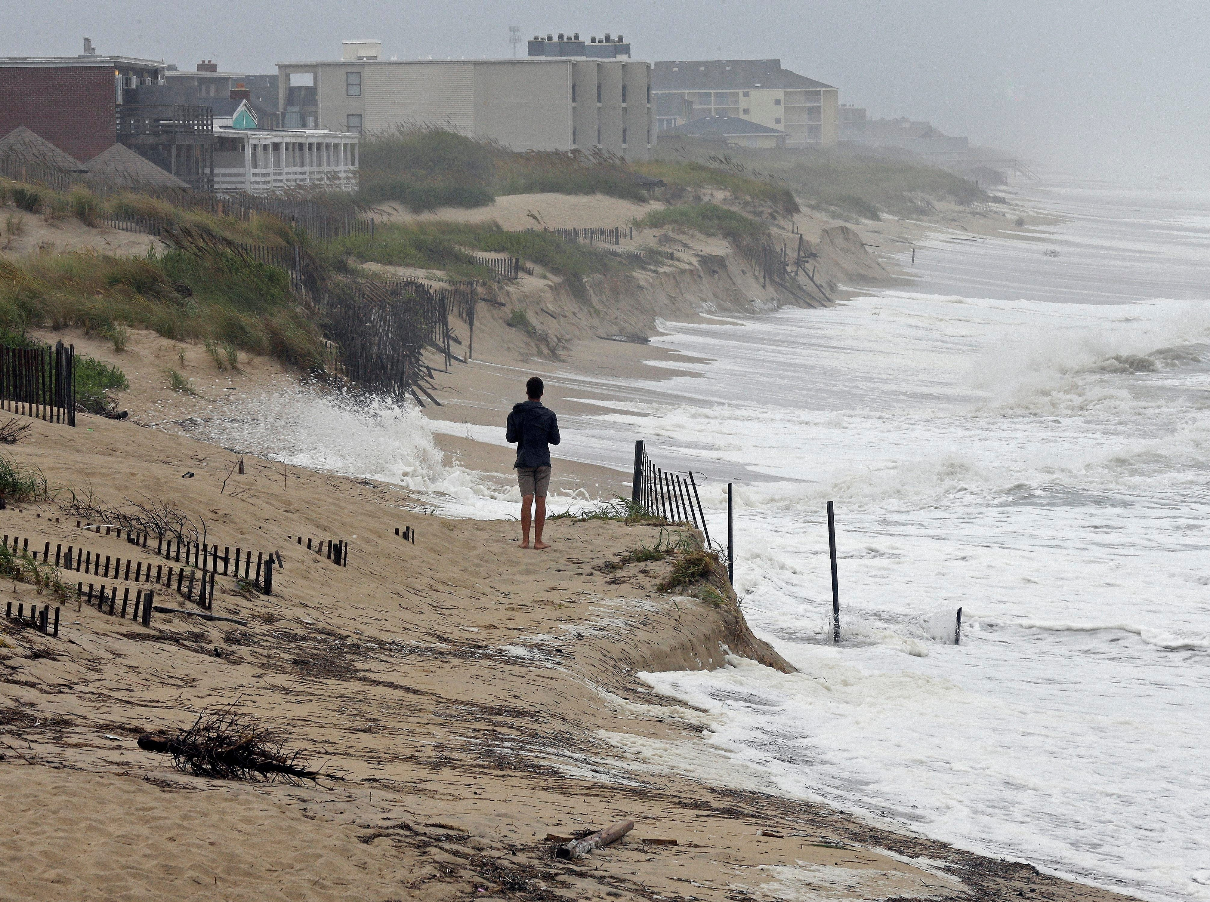 Heavy surf crashes the dunes at high tide in Nags Head, N.C., Thursday, Sept. 13, 2018 as Hurricane Florence approaches the east coast. (AP Photo/Gerry Broome)