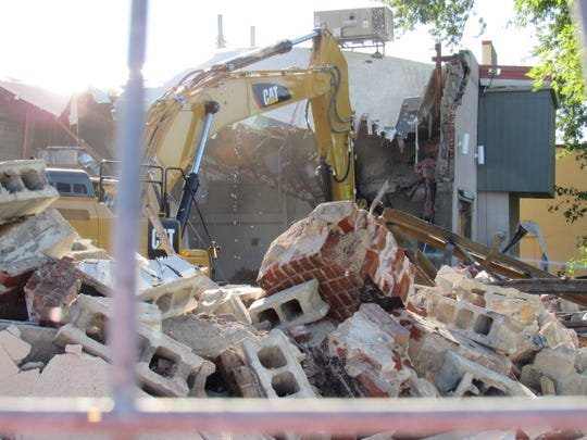 Crews continue to tear down the former Central Wisconsin Cultural Center building at 240 Johnson St. on Thursday, Sept. 13, 2018. The building originally housed the Palace Theater from 1915-1957 and several stores including Ed-Syl Furniture Centre, Sears & Roebuck Co. and DeByle's through the years.
