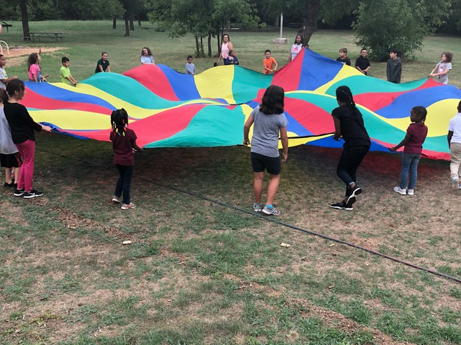 In this file photo, Camp Fire members enjoyed Parachute Ice Breaker Games, a fun way for the kids to get to know each other and make new friends from different schools.