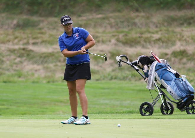 Zanesville's Jewel Goins putts during a match with Tri-Valley and John Glenn this past fall at Zanesville Country Club. Goins will join her sister, Joslyn, after signing her letter of intent to play for Ohio Valley University.