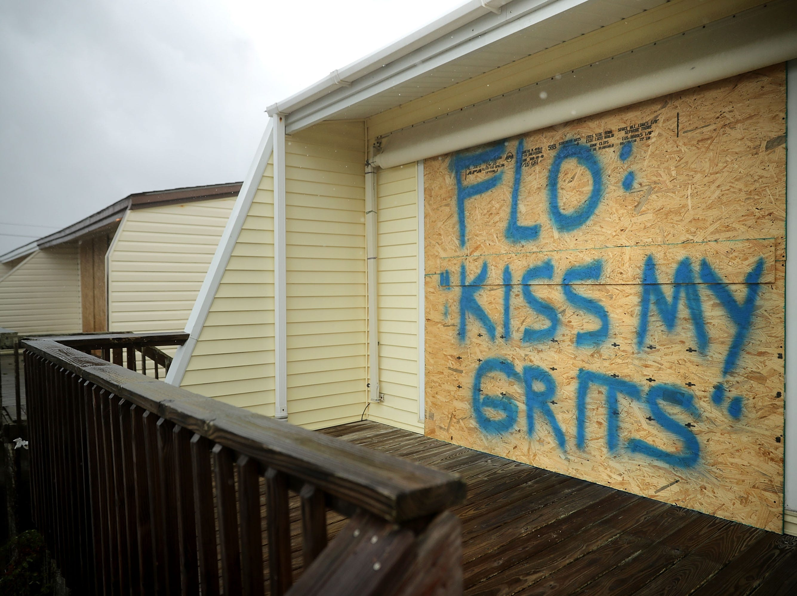 A spray painted message is left on a boarded up condominium as the outer bands of Hurricane Florence being to affect the coast Sept. 13, 2018 in Atlantic Beach, United States. Coastal cities in North Carolina, South Carolina and Virginia are under evacuation orders as the Category 2 hurricane approaches the United States.