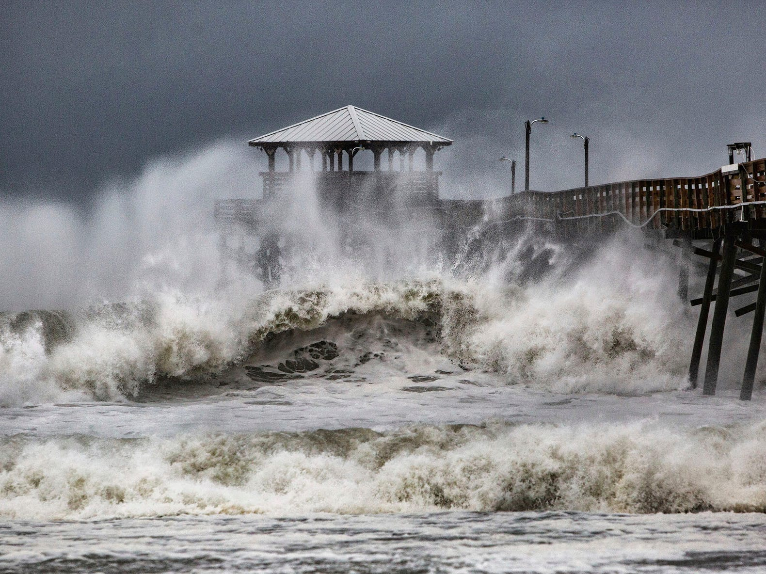 Waves slam the Oceana Pier & Pier House Restaurant in Atlantic Beach, N.C.,  Thursday, Sept. 13, 2018 as Hurricane Florence approaches the area.