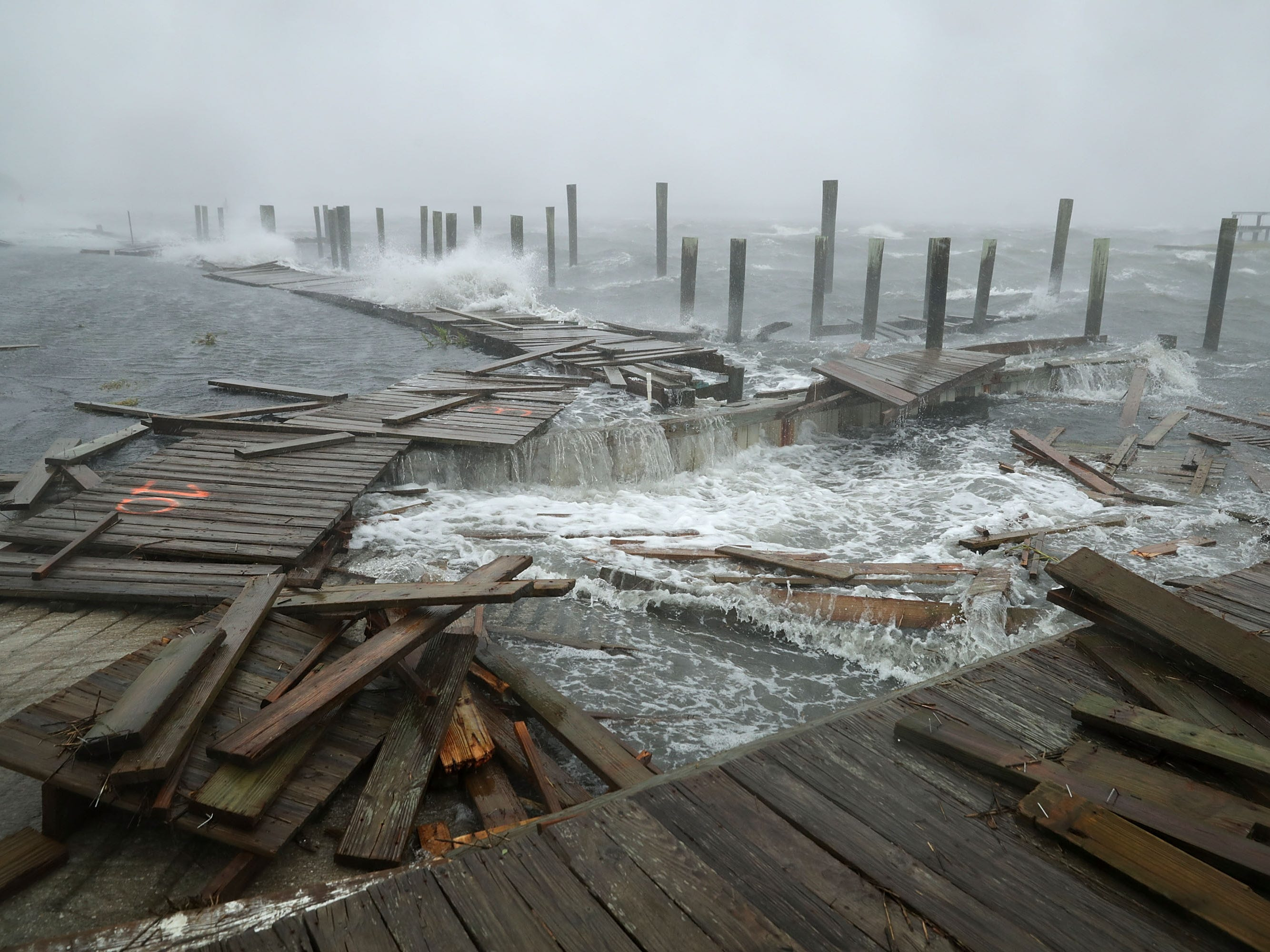 Portions of a boat dock and boardwalk are destroyed by powerful wind and waves as Hurricane Florence arrives Sept. 13, 2018, in Atlantic Beach, N.C.