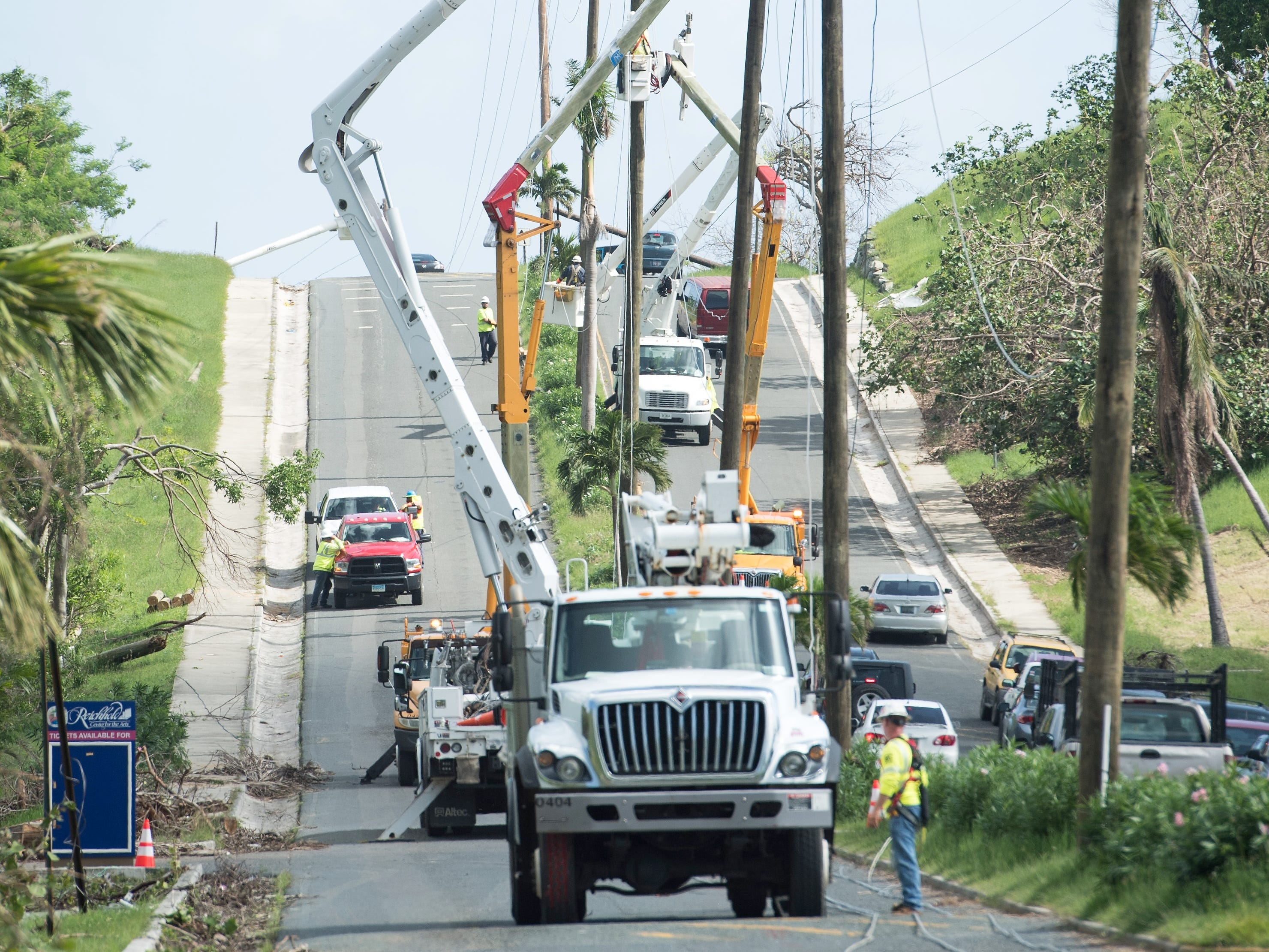 Crews work to restore power near The University of the Virgin Islands in St. Thomas after Hurricane Irma, Oct. 23, 2017.