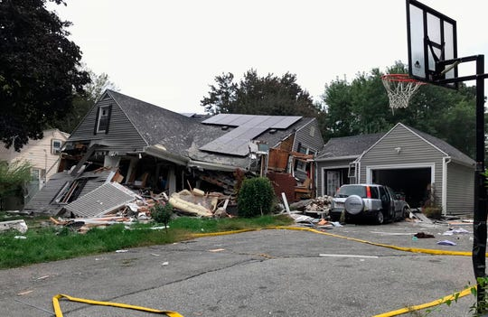 A house is destroyed in Lawrence, Mass., Thursday, Sept. 13, 2018 after a series of fires and possible gas explosions in the area. First-responders continued to fight fires in Lawrence, Andover and North Andover Mass.