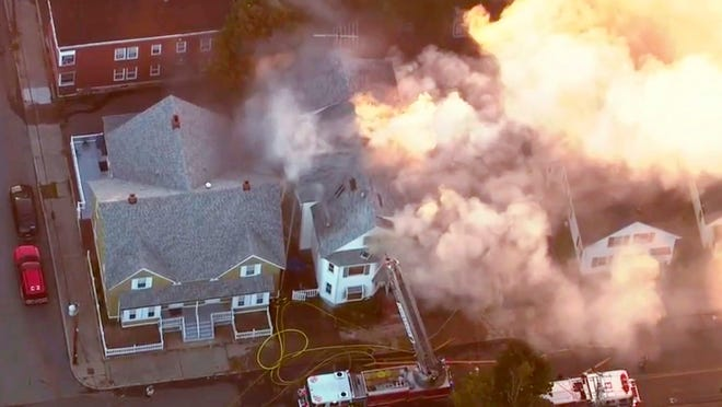 In this image take from video provided by WCVB in Boston, firefighters battle a large structure fire in Lawrence, Mass, a suburb of Boston, Thursday, Sept. 13, 2018. Emergency crews are responding to what they believe is a series of gas explosions that have damaged homes across three communities north of Boston.