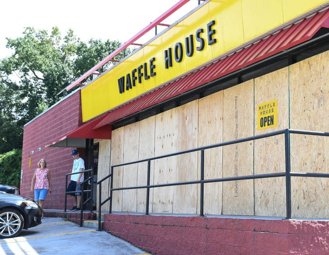A Waffle House on state highway 421 in Wilmington, North Carolina, says it would be open through Hurricane Florence. Waffle House is one of few businesses that usually remains open during natural disasters.