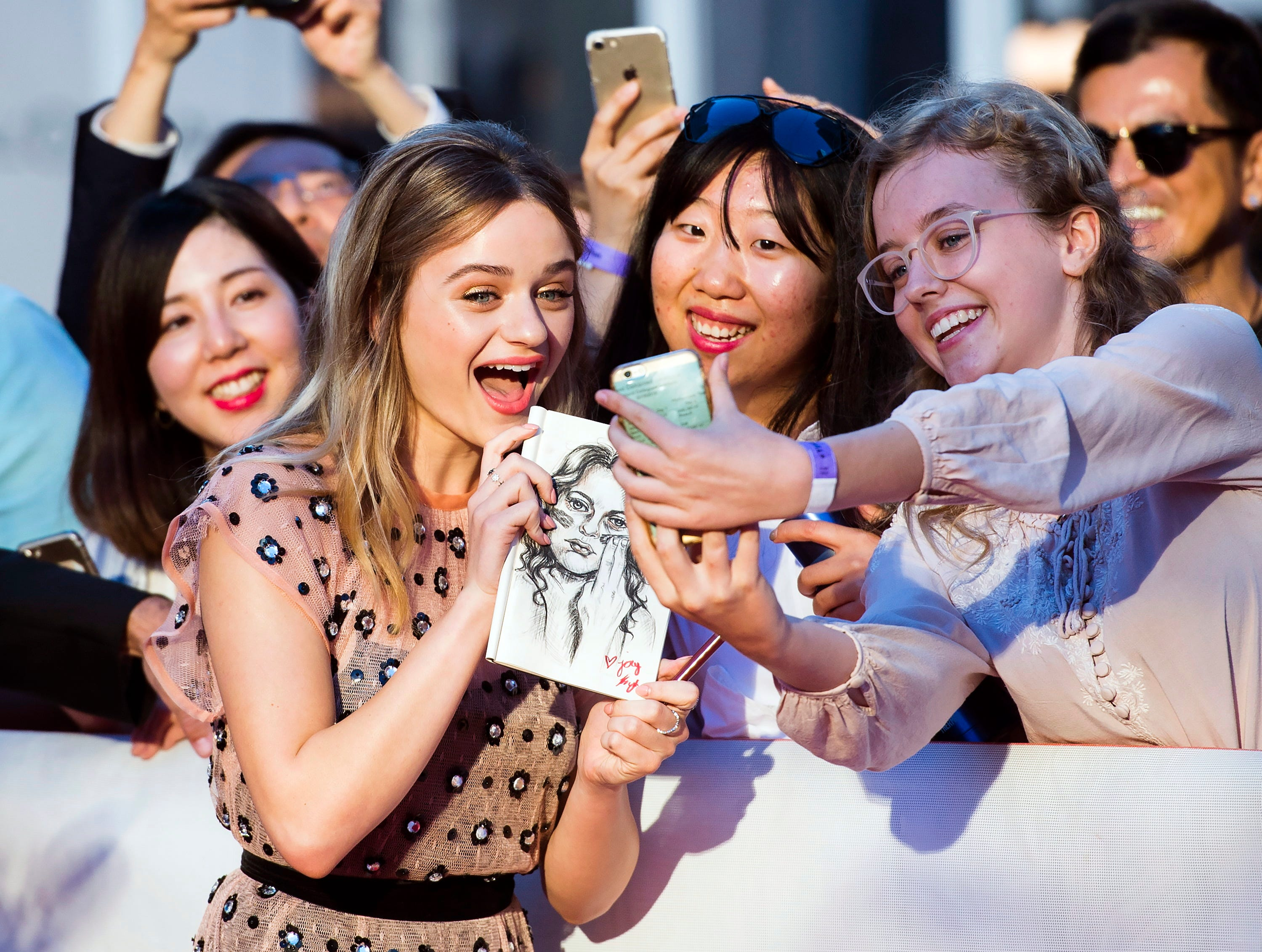 "Actress Joey King poses for photographs on the red carpet for the film ""The Lie"" during the 2018 Toronto International Film Festival in Toronto on Thursday, Sept. 13, 2018. (Nathan Denette/The Canadian Press via AP) ORG XMIT: NSD110"