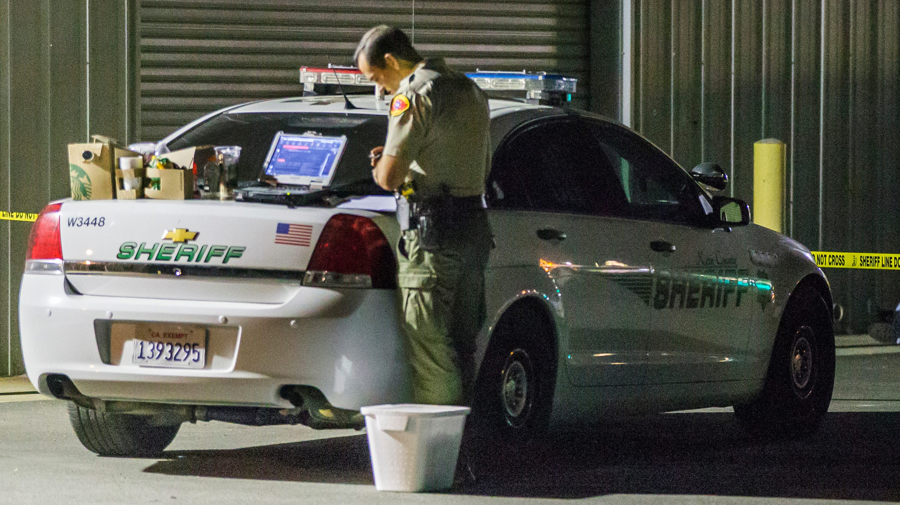 A Kern County sheriff's deputy stands near a closed area in Bakersfield, California.