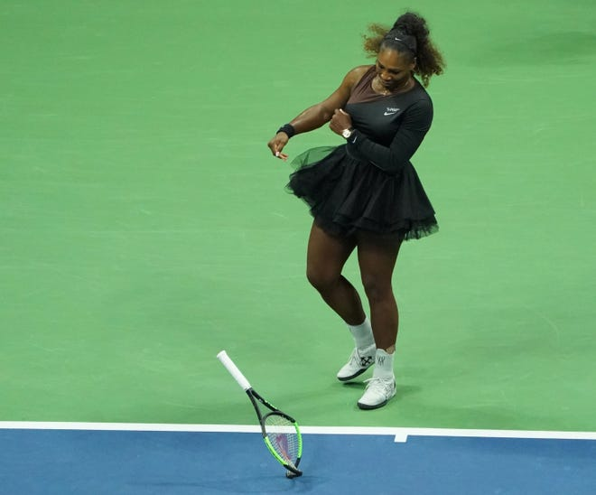 Serena Williams smashes her racket while playing Naomi Osaka during the US Open final.
