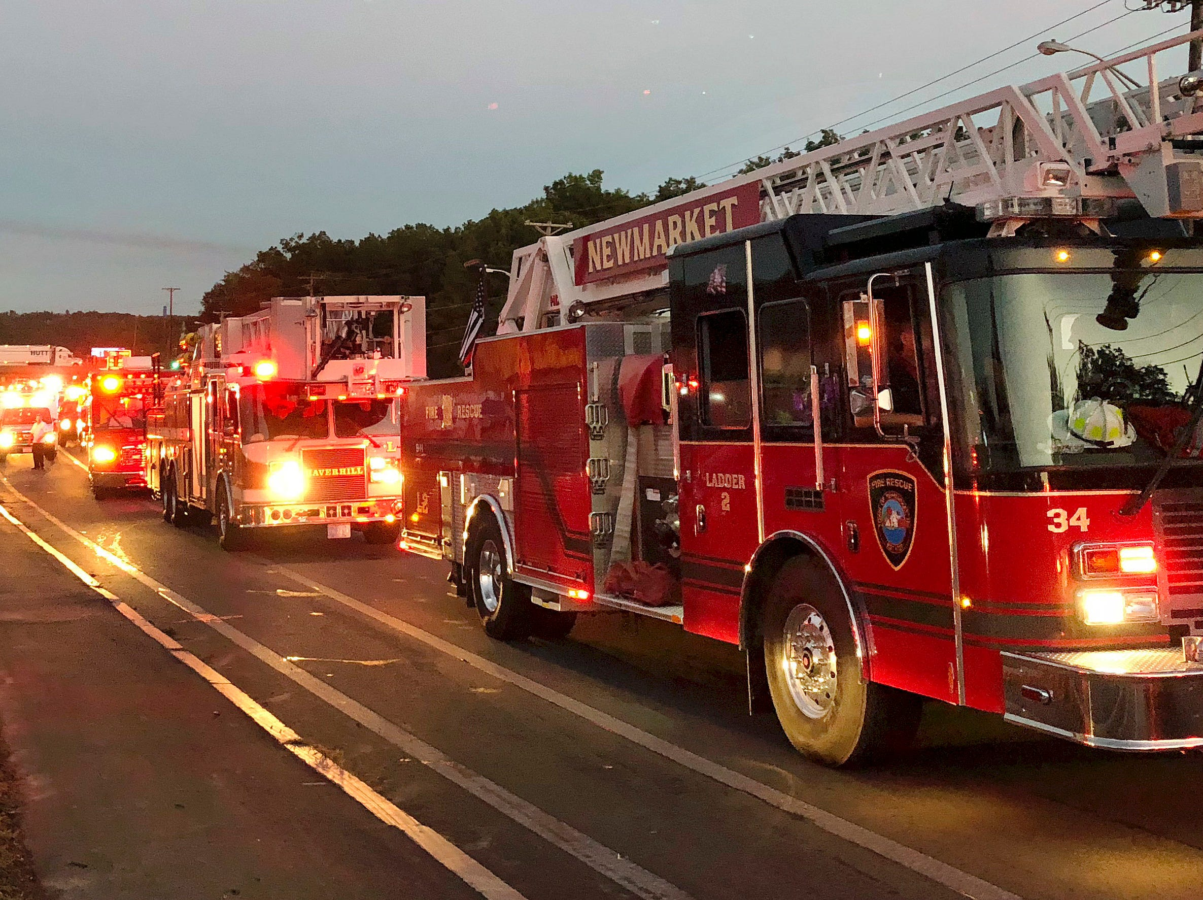 Multiple fire trucks from surrounding communities arrive Thursday, Sept. 13, 2018, in Lawrence, Mass., responding to a series of fires triggered by a problem with a gas line that feeds homes in several communities north of Boston.