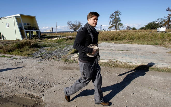 Brad Pitt walks in the Lower Ninth Ward near a home built by his Make It Right foundation in New Orleans in December 2008.