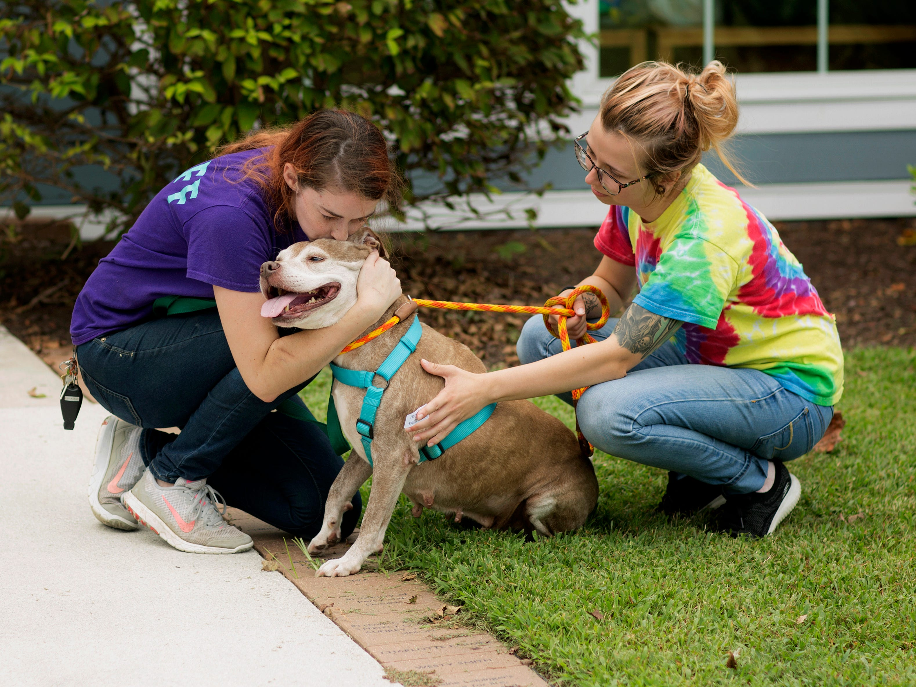 Amanda Glaze says goodbye to Hi-Ho Silver outside the Portsmouth Humane Society, in Portsmouth, Va. The Humane Society of the United States, Animal Rescue Team relocated cats and dogs from the Portsmouth Humane Society in preparation of Hurricane Florence.