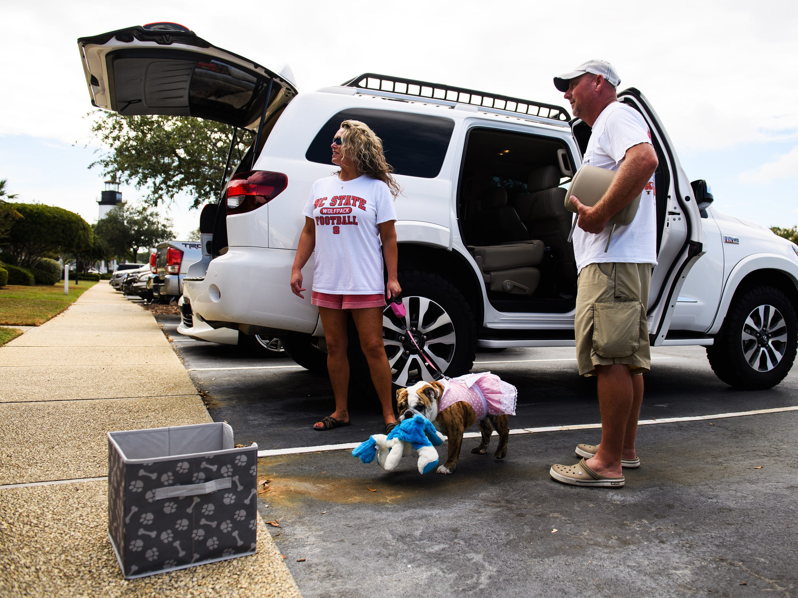 Billy and Stacy Prince and their dog Pixie begin packing up their vehicles to evacuate their North Myrtle Beach home.