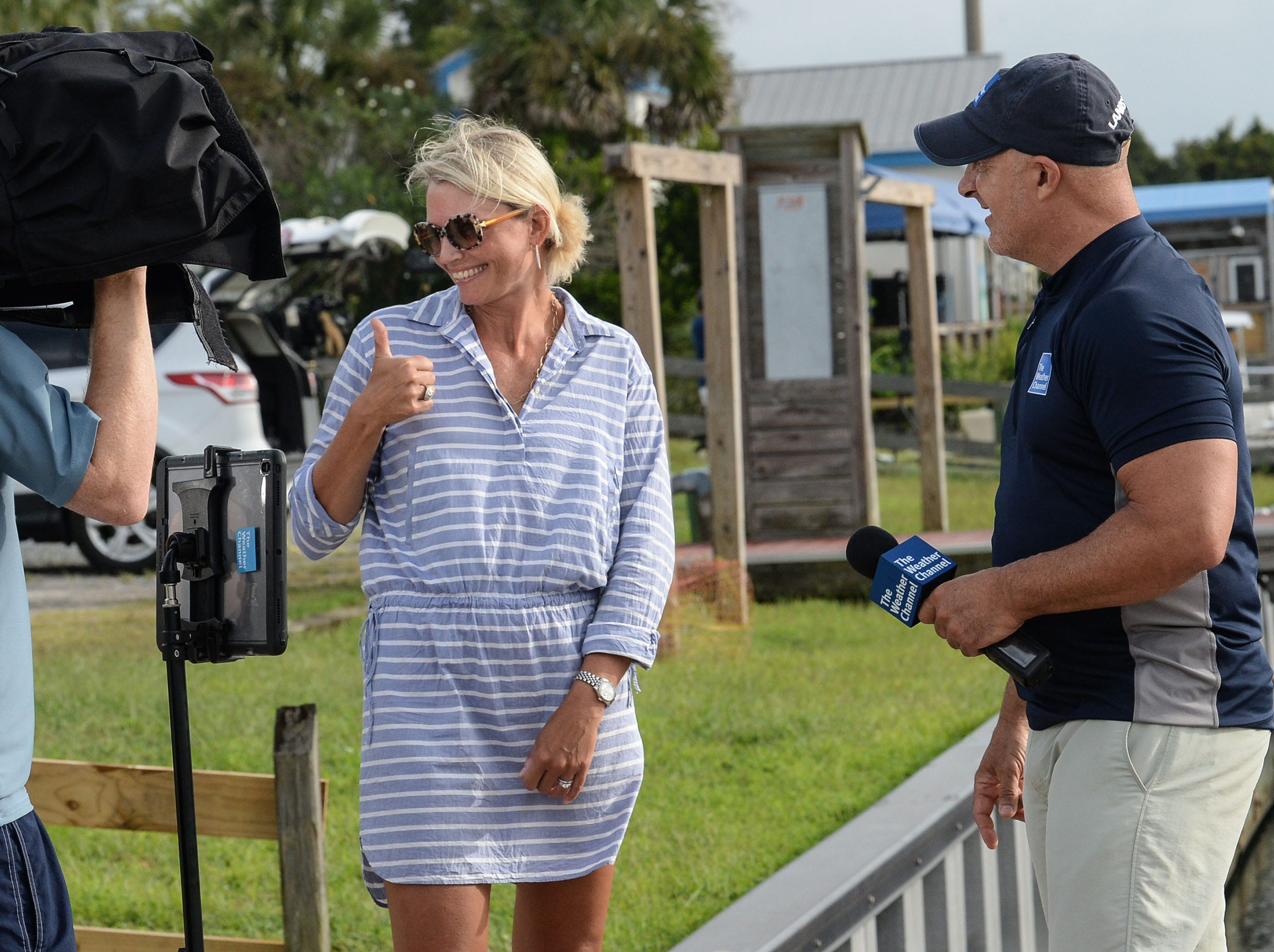 Amy Neathery, left of Wilmington, N.C. gives a thumbs up to family watcher her get interviewed by Jim Cantore of The Weather Channel, before Hurricane Florence hit on Thursday, Sept. 13, 2018.