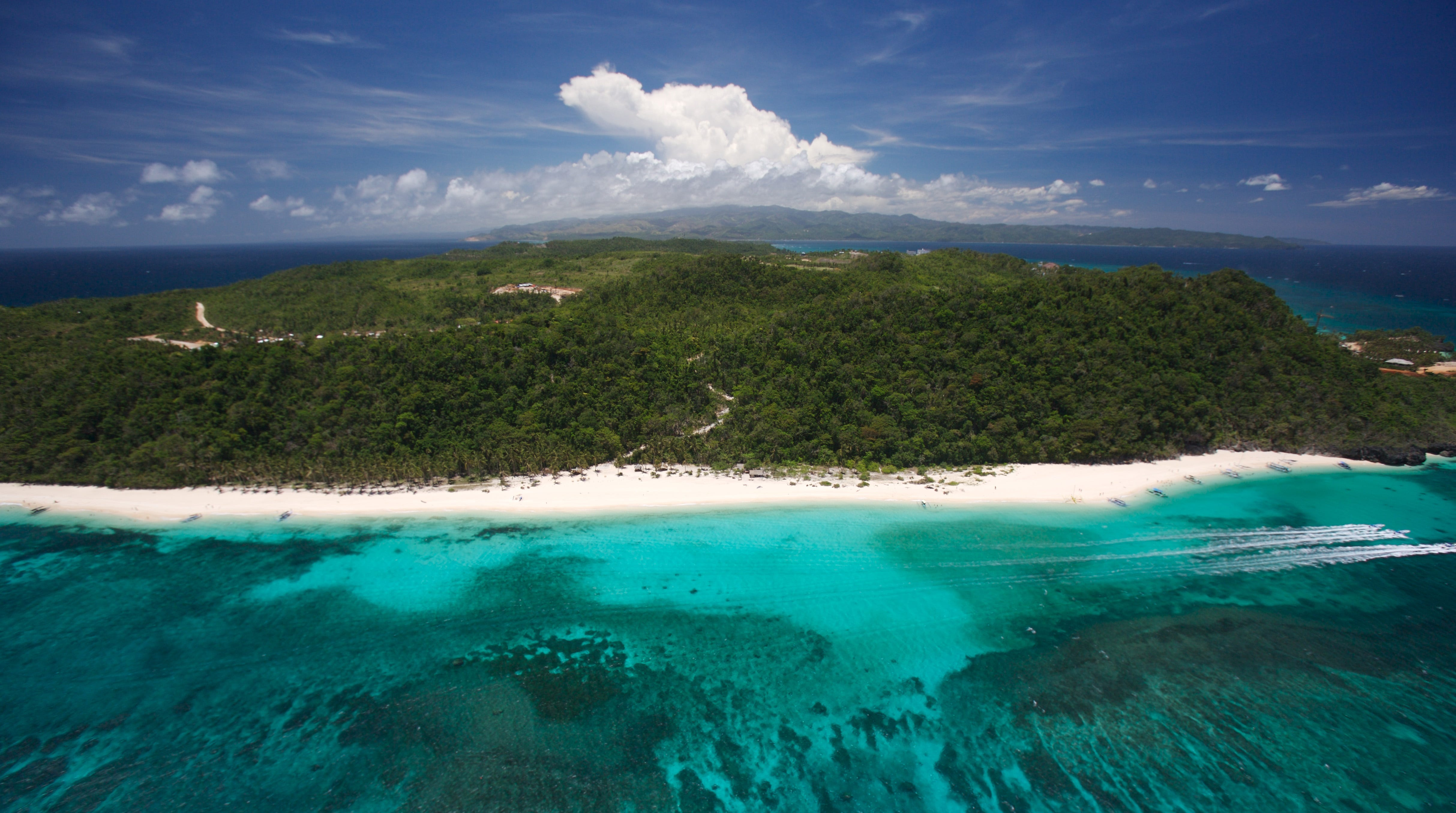 Blue skies and turquoise water frame Boracay, an island in the Philippines.