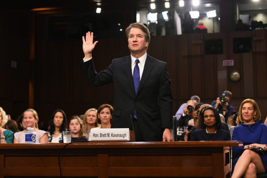 Supreme Court nominee Brett Kavanaugh is sworn in before the Senate Judiciary Committee.