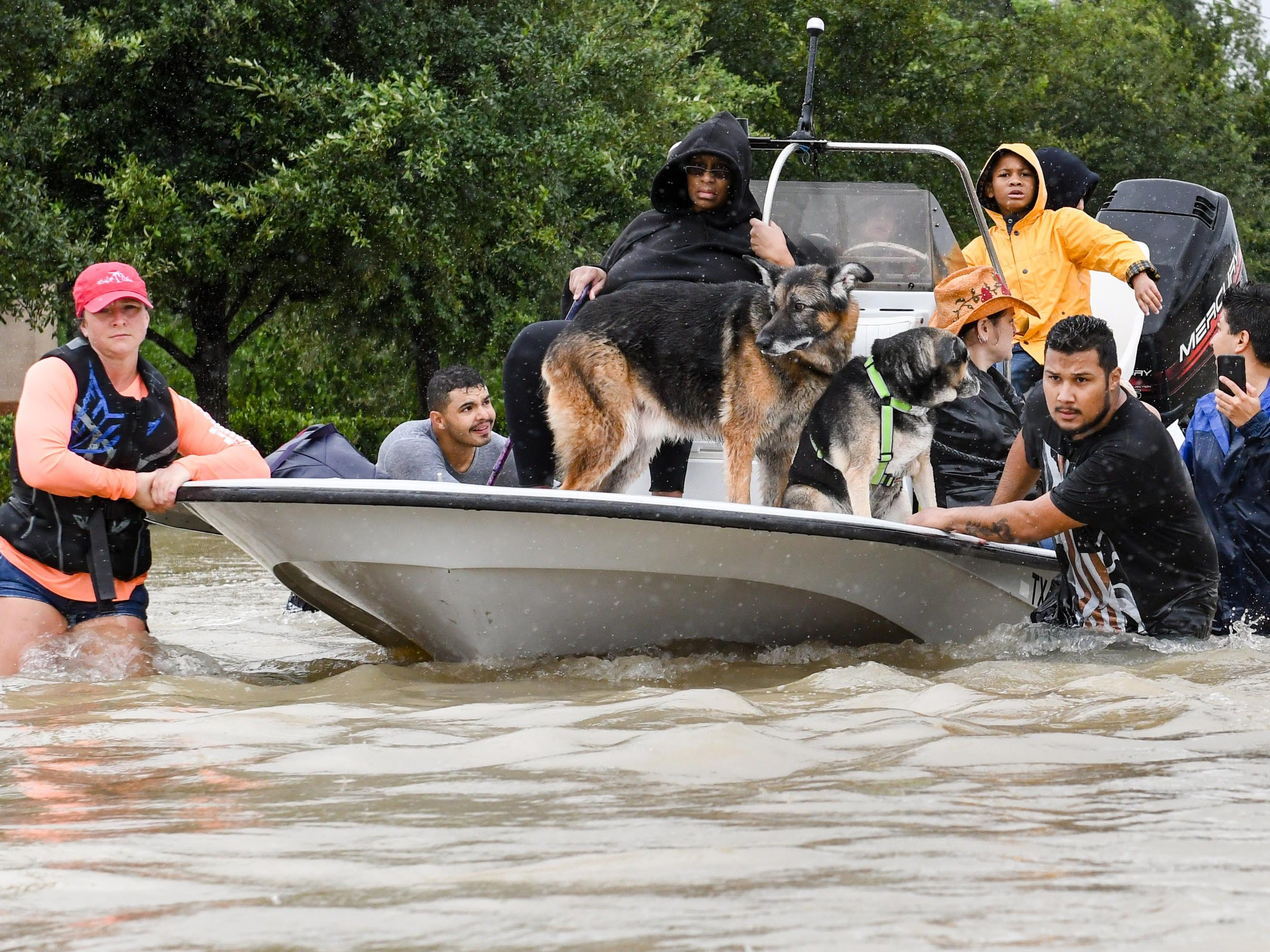 Volunteers and first responders work together to rescue residents from rising flood waters from Hurricane Harvey, Aug. 29, 2017, in Houston.