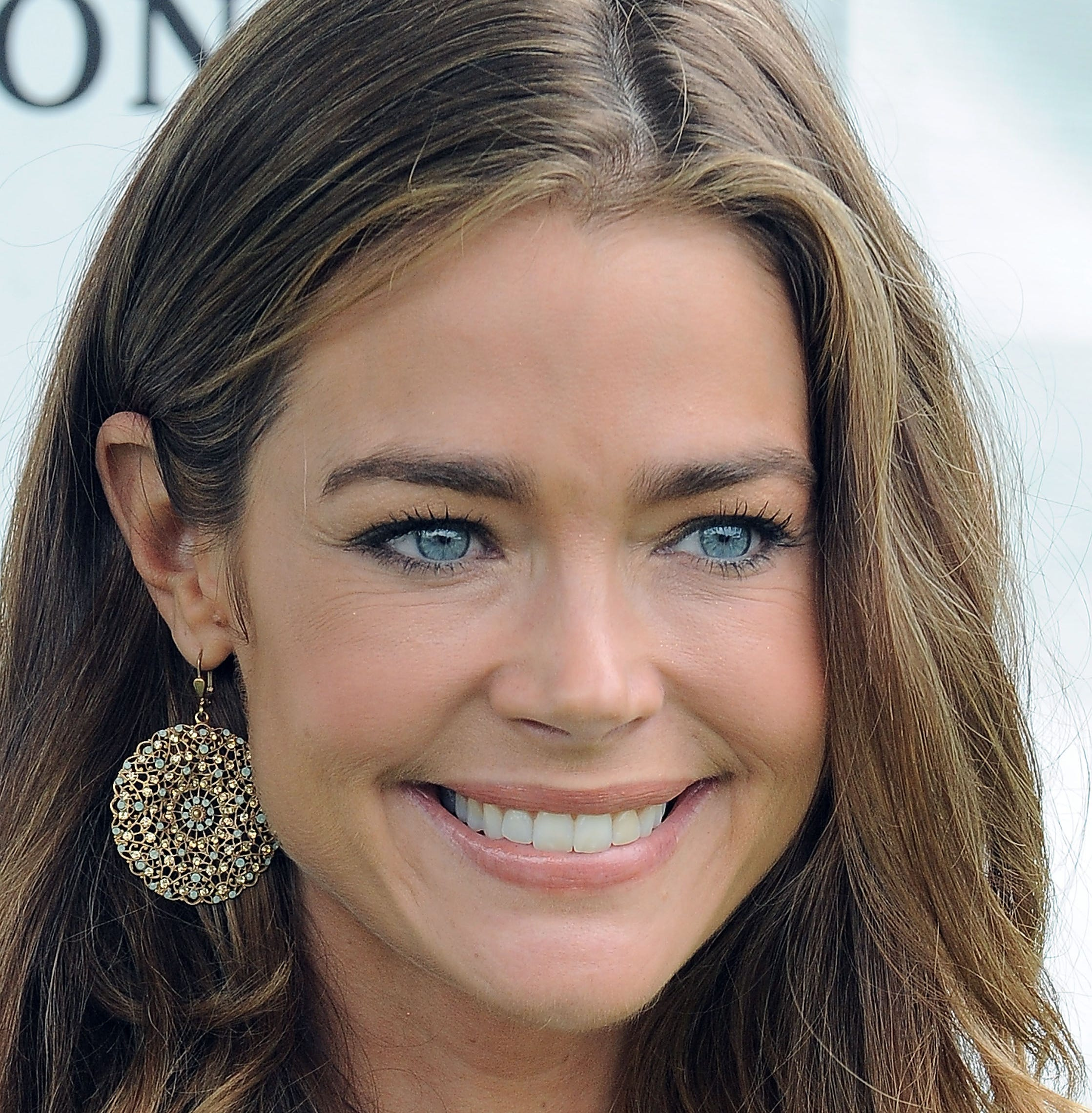 "Denise Richards got married Denise Richards style in a ""sexy"" and short dress."